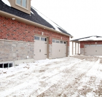 the-empey-side-view-of-garage-and-extra-garage